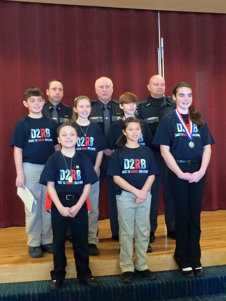 d.a.r.e essay winners The pineview elementary school's fifth-grade dare essay winners are (back row) emily schullenberger, jt scott.